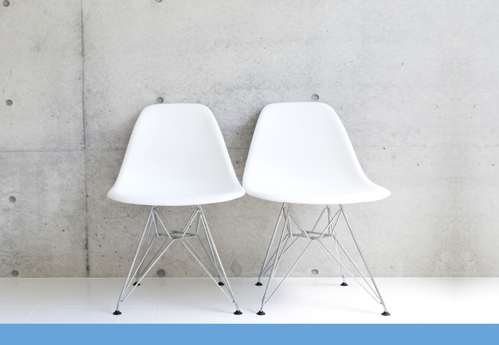 Two Chairs Against a Wall