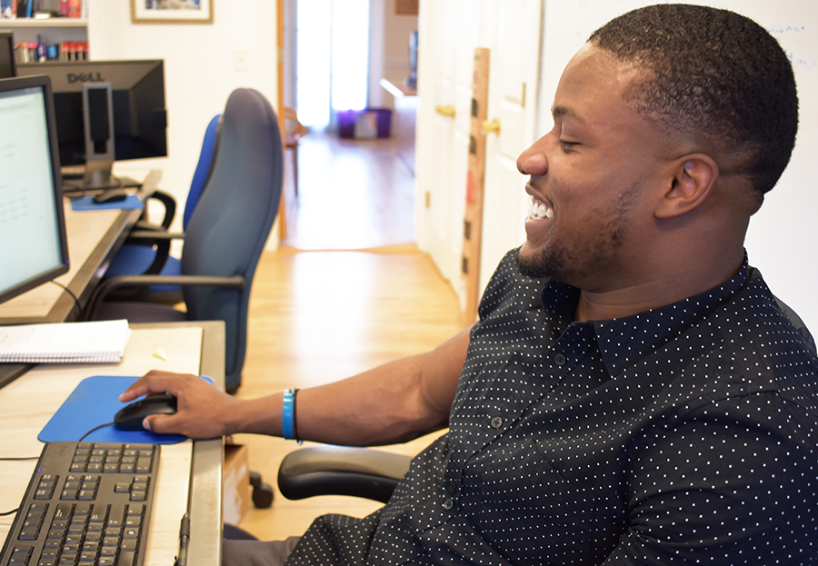 ForeFront Employee Laughing While Working at Computer