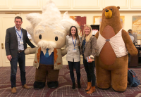 ForeFront Employees with Mascots at Salesforce Event