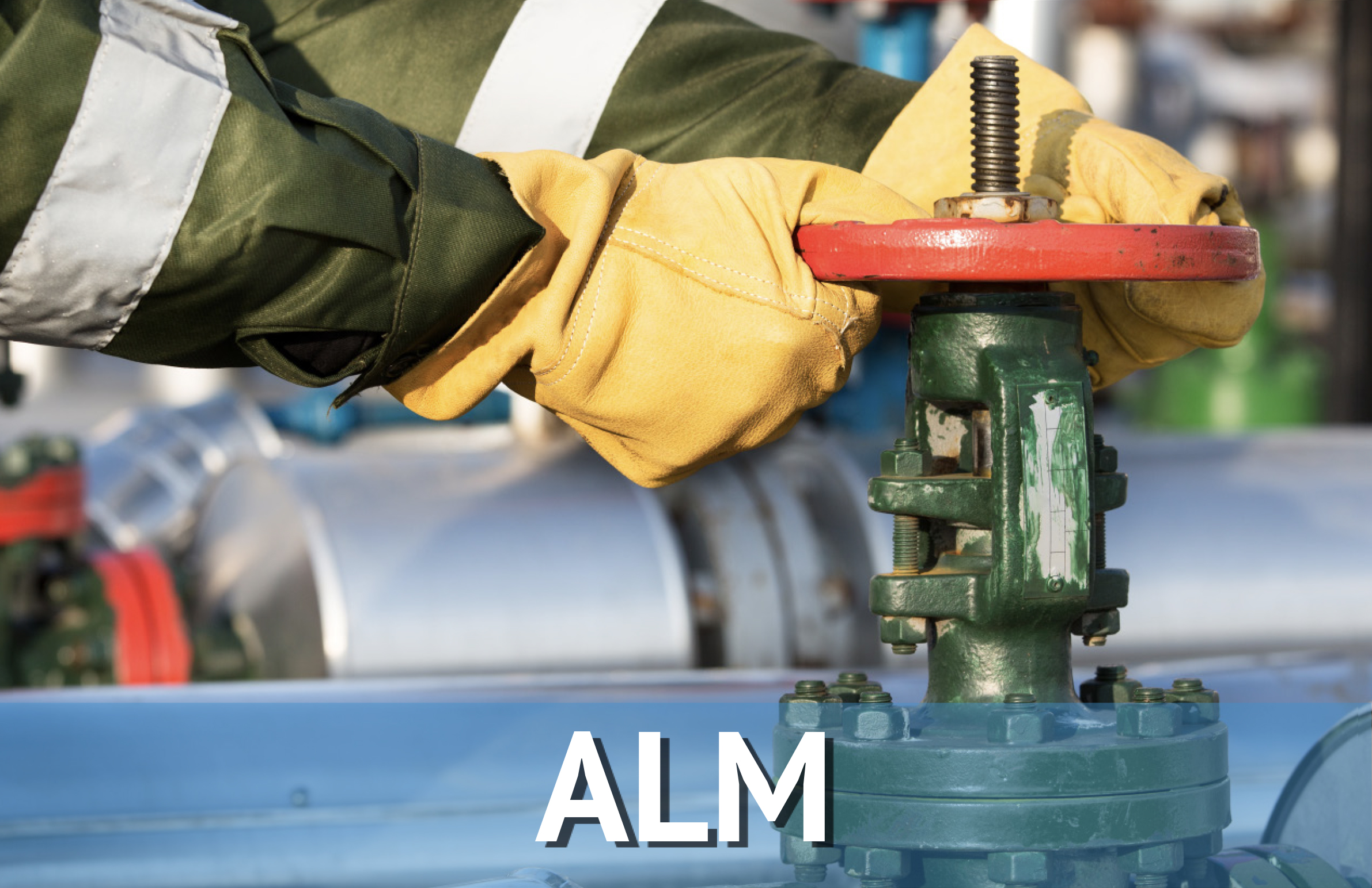 Hands Turning an Industrial Valve, Labeled ALM