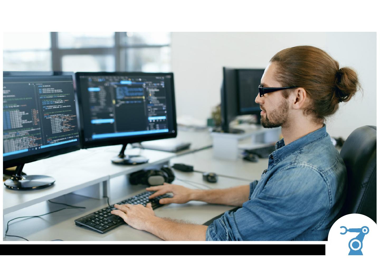 High Tech Worker Coding at Office Desk