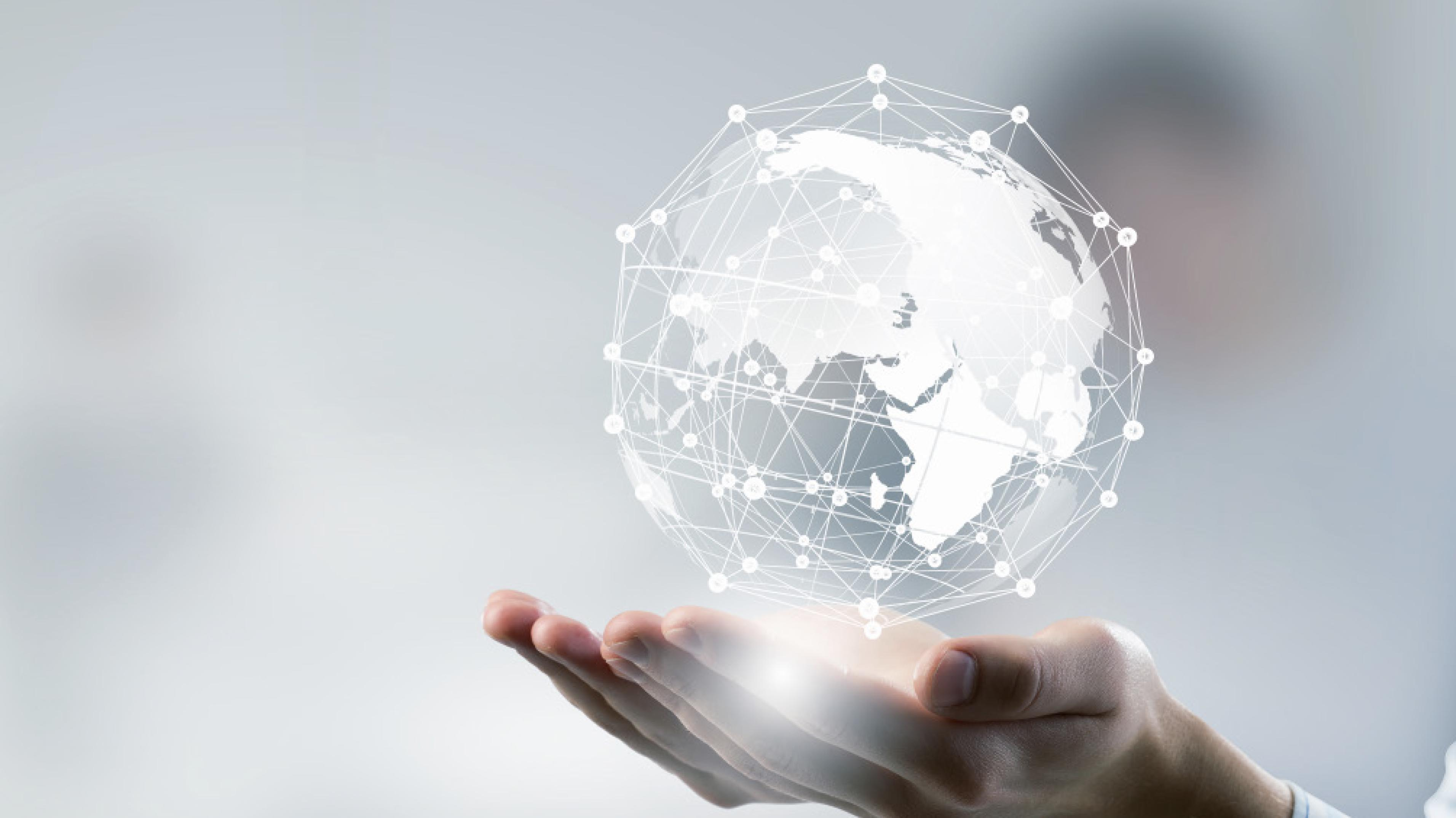 Hands Holding A Globe of Technology