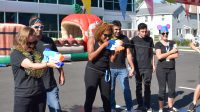 Employees Playing a Game with Water Guns